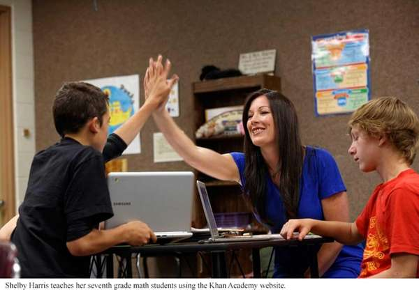 Shelby Harris high-fives one of her 7th grade