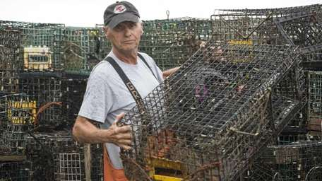 Commercial fisherman Phil Karlin stands near a couple