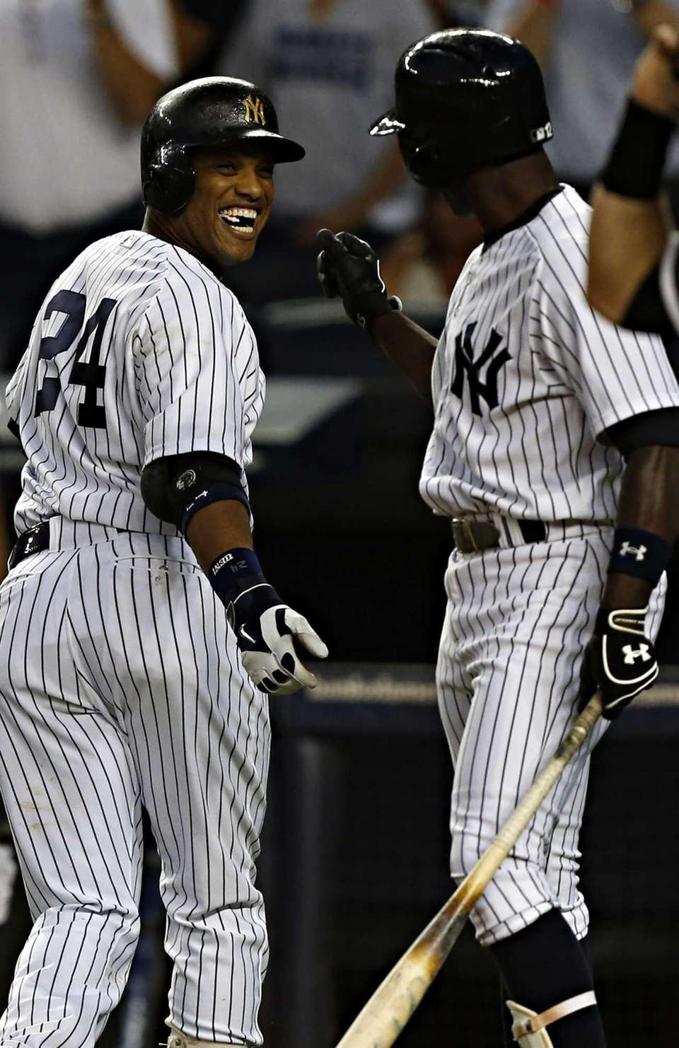 Robinson Cano (24) jokes with Alfonso Soriano (12)