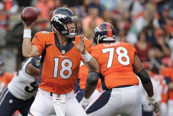 Denver Broncos quarterback Peyton Manning (18) steps back