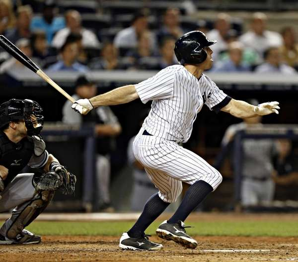 Yankees center fielder Brett Gardner (11) triples to