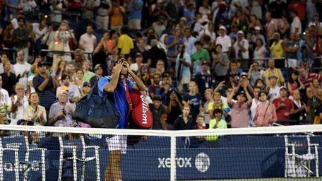 Roger Federer of Switzerland walks off the court