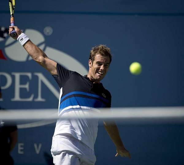Richard Gasquet hits a backhand against David Ferrer