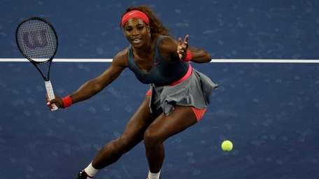 Serena Williams plays a forehand during her women's