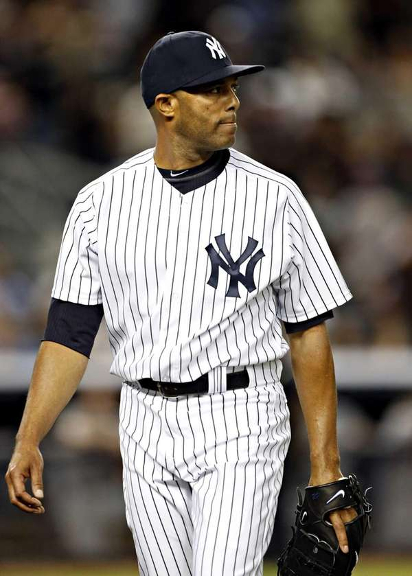 Yankees relief pitcher Mariano Rivera leaves the field
