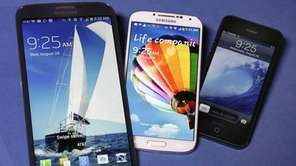 The Samsung Galaxy Mega, left, Samsung Galaxy S4,
