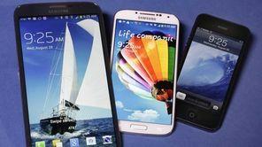 The Samsung Galaxy Mega, left, Samsung Galaxy S4,