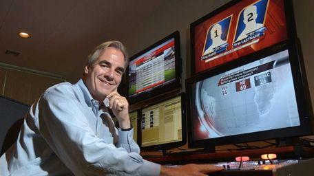 ChyronHego CEO Michael Wellesley-Wesley, next to a bank