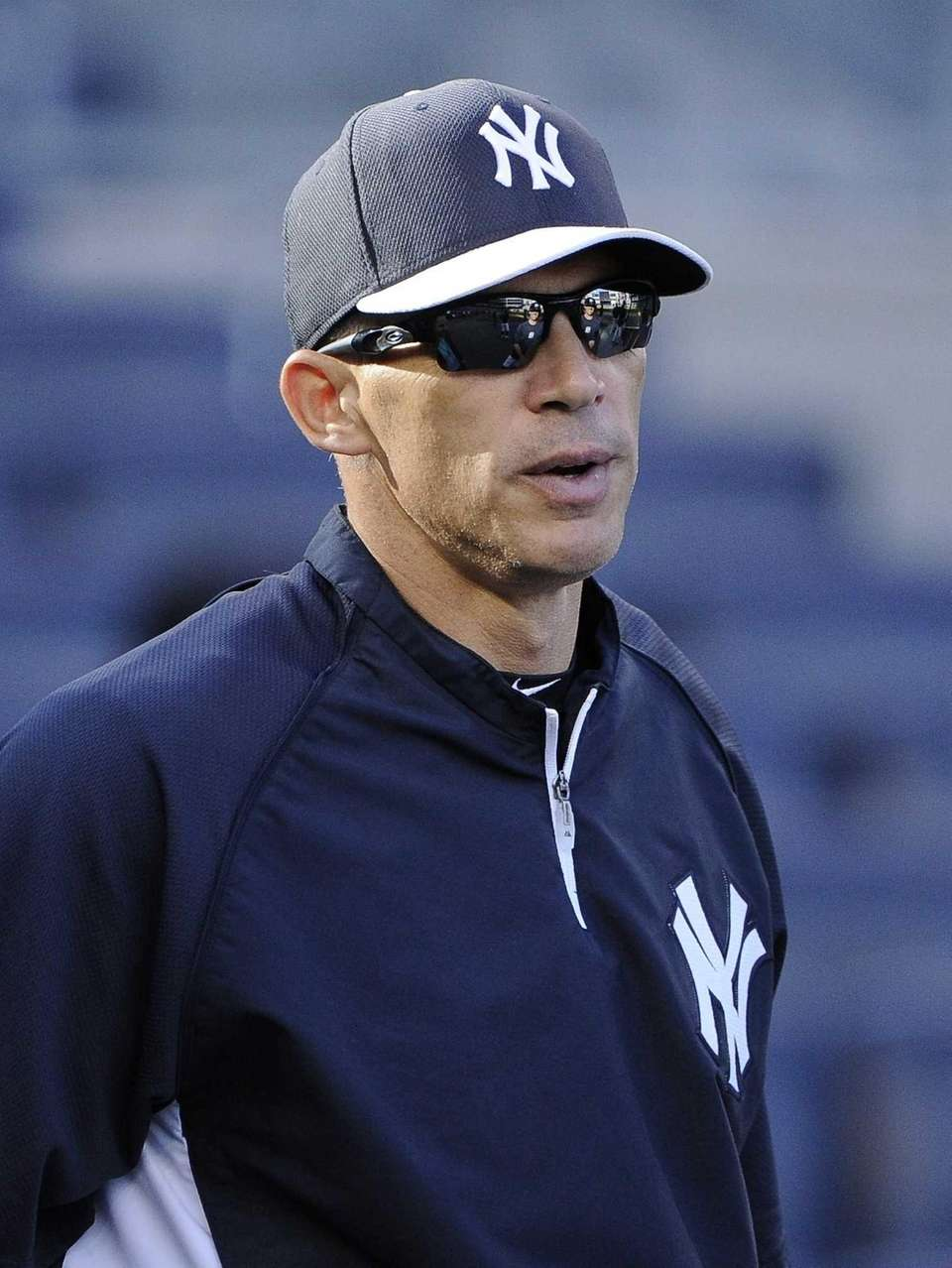 Yankees manager Joe Girardi looks on during batting