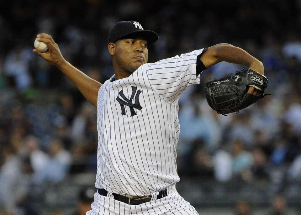 Yankees starting pitcher pitcher Ivan Nova delivers against