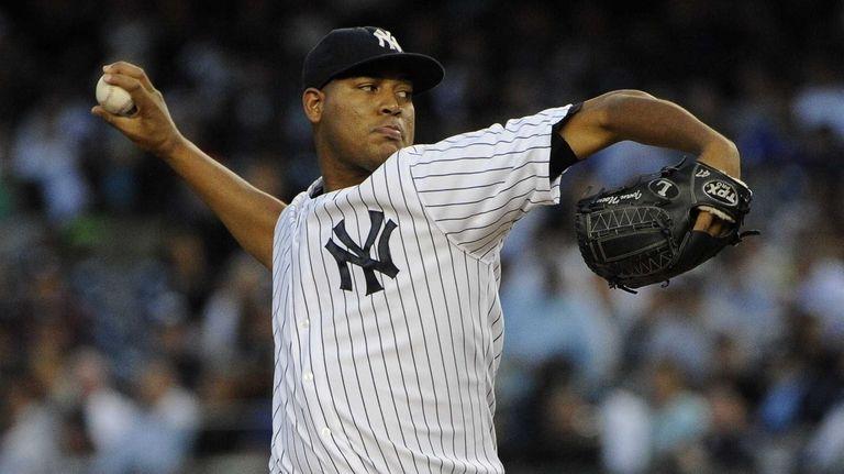 Yankees starting pitcher pitcher Ivan Nova delivers against