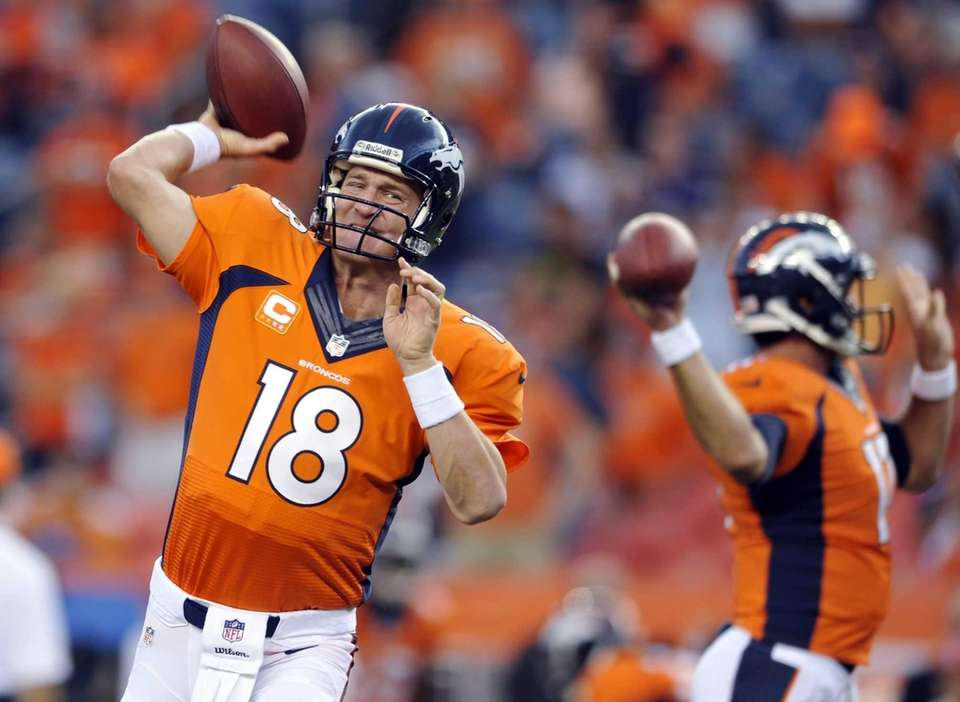 Denver Broncos quarterback Peyton Manning warms up prior