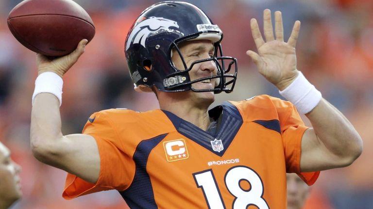 Denver Broncos quarterback Peyton Manning warms up prior