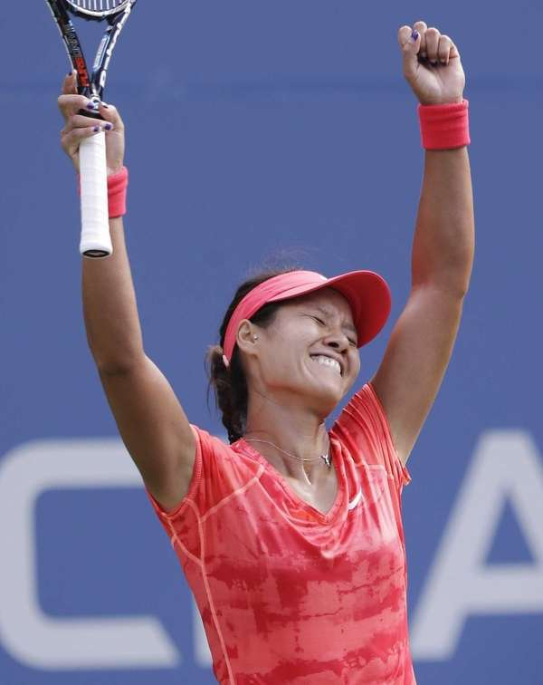 Li Na, of China, reacts after beating Ekaterina