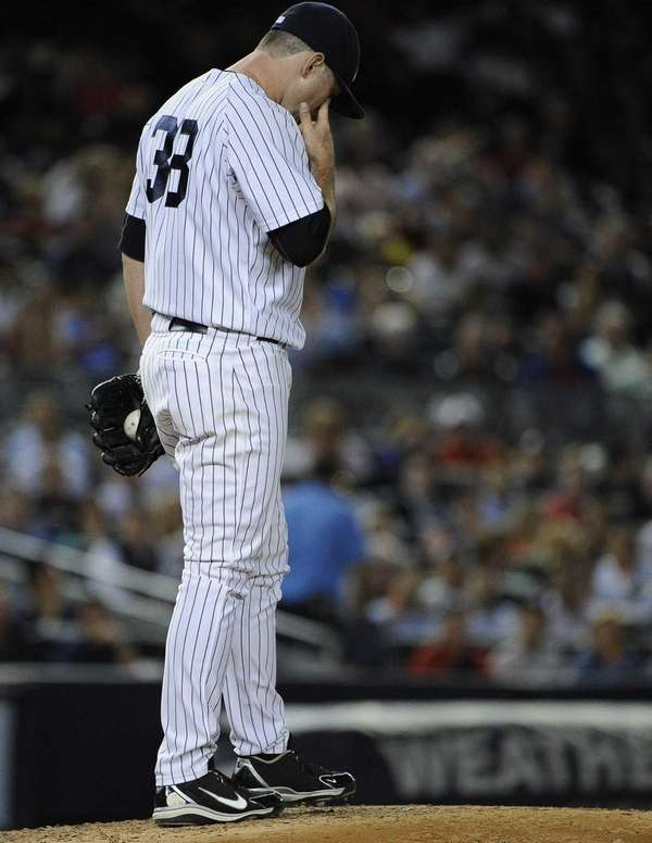 Yankees relief pitcher Preston Claiborne reacts on the
