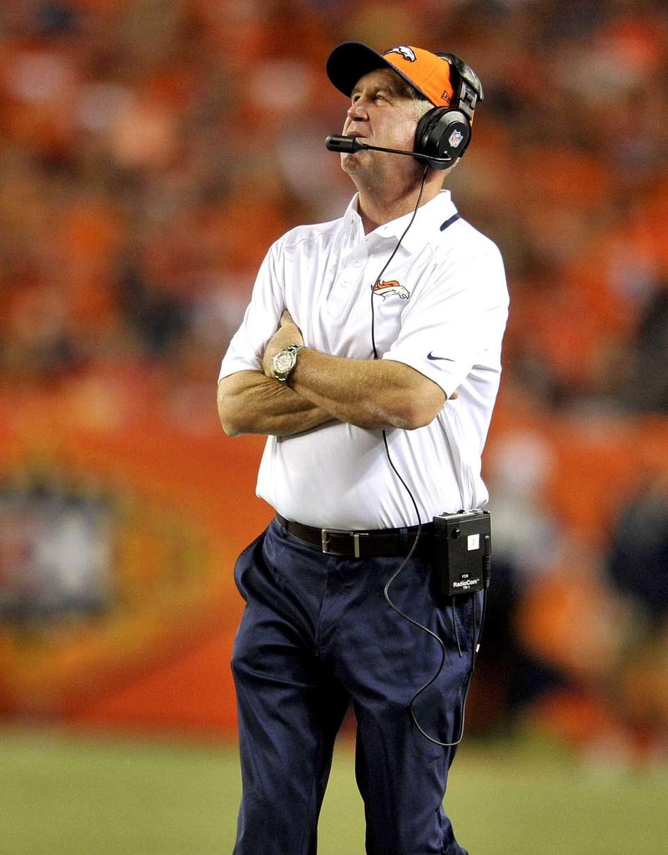 Denver Broncos coach John Fox looks at the