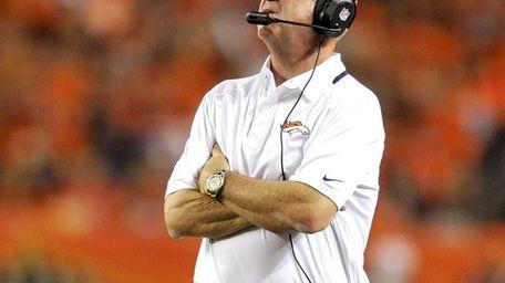 Denver Broncos coach John Fox looks at the