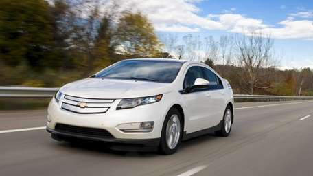 GM deliveries of its Chevrolet Volt plug-in, above,