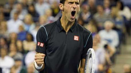 Novak Djokovic reacts after winning a break point
