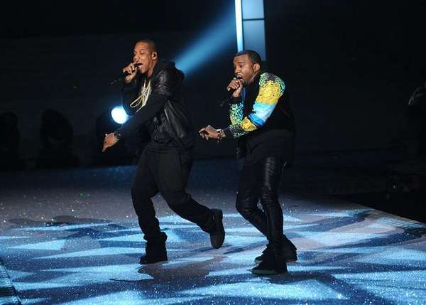 From left, Jay Z and Kanye West perform