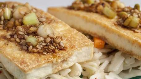 Soy-glazed tofu with spicy cabbage salad. (Sept. 5,