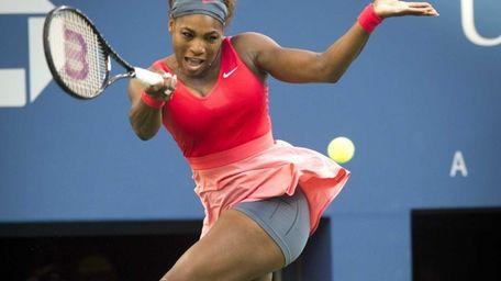 Serena Williams hits a running forehand against Li