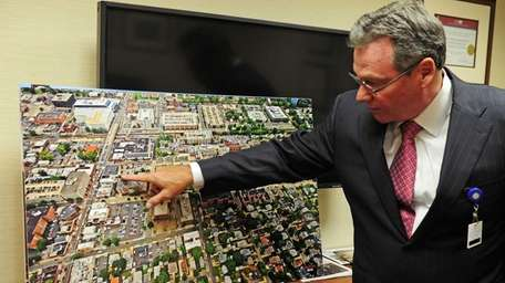 Winthrop-University Hospital President/CEO, John F. Collins shows where