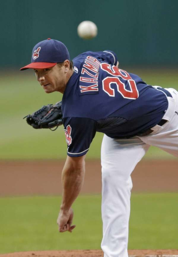Cleveland Indians starting pitcher Scott Kazmir delivers against
