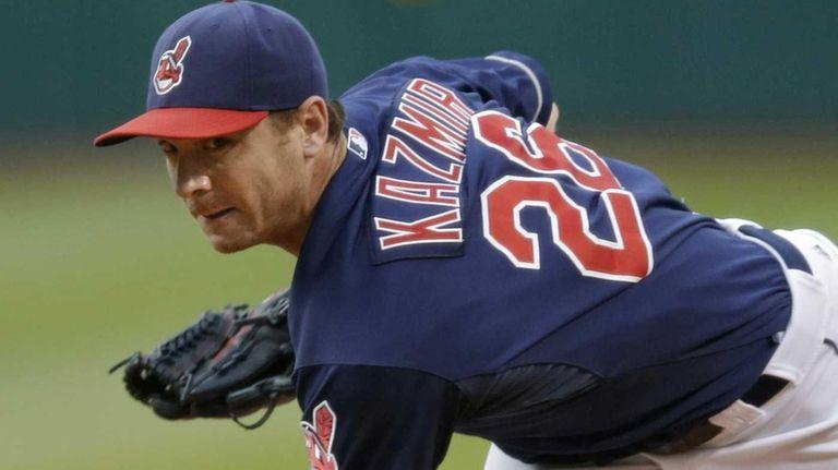 Cleveland Indians starting pitcher Scott Kazmir delivers against