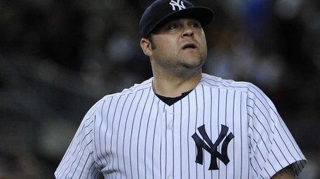 Yankees pitcher Joba Chamberlain looks up as he