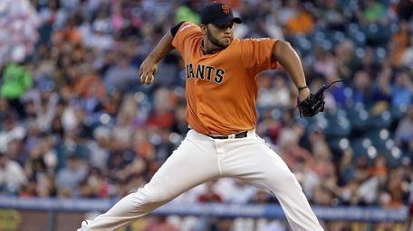 San Francisco Giants starting pitcher Yusmeiro Petit throws