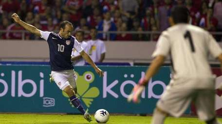 United States' Landon Donovan, left, prepares to kick