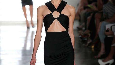 A model walks the runway at the Cushnie
