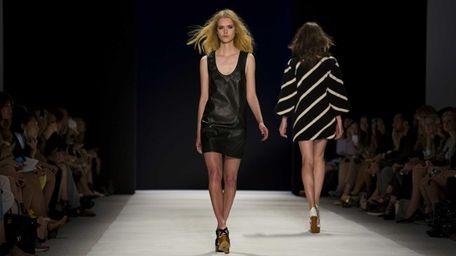 A model walks the runway at the Jill