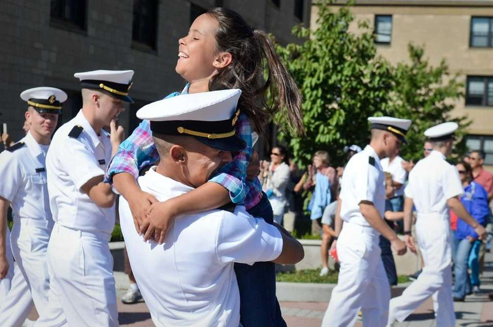 Midshipman Justin Lindstrom of Dallas hugs his sister