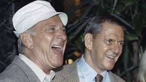 Jack Klugman, left, and Tony Randall laugh at