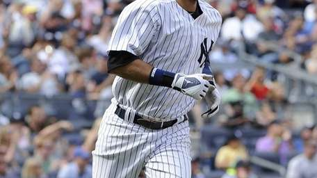 Yankees' Derek Jeter runs to first base on