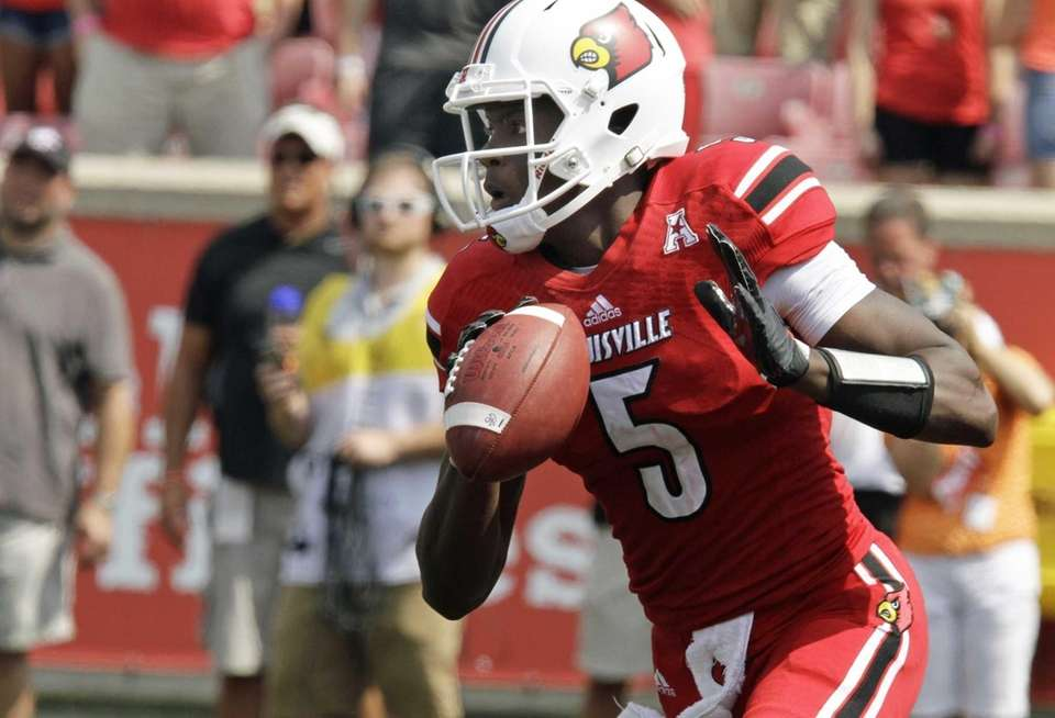 Louisville quarterback Teddy Bridgewater rolls out looking to