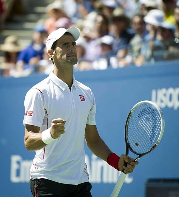 Novak Djokovic reacts after breaking Stanisias Wawrinka during