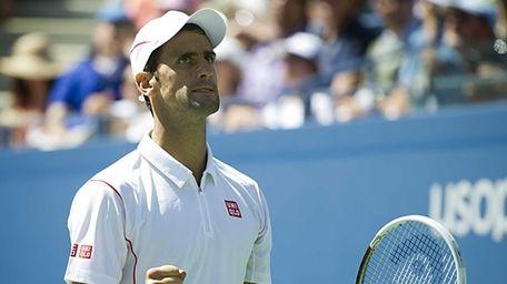 Novak Djokovic reacts after breaking Stanisias Wawrinka during