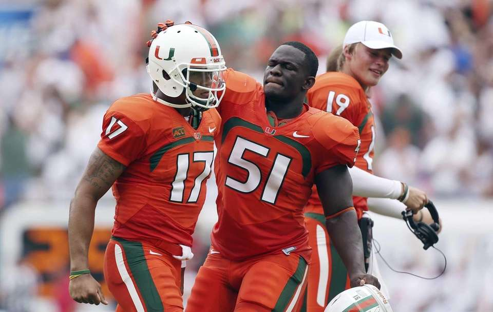 Miami quarterback Stephen Morris (17) and Shayon Green