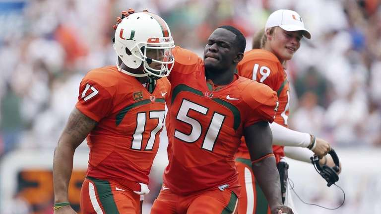 Miami quarterback Stephen Morris (17) and Shayon Green