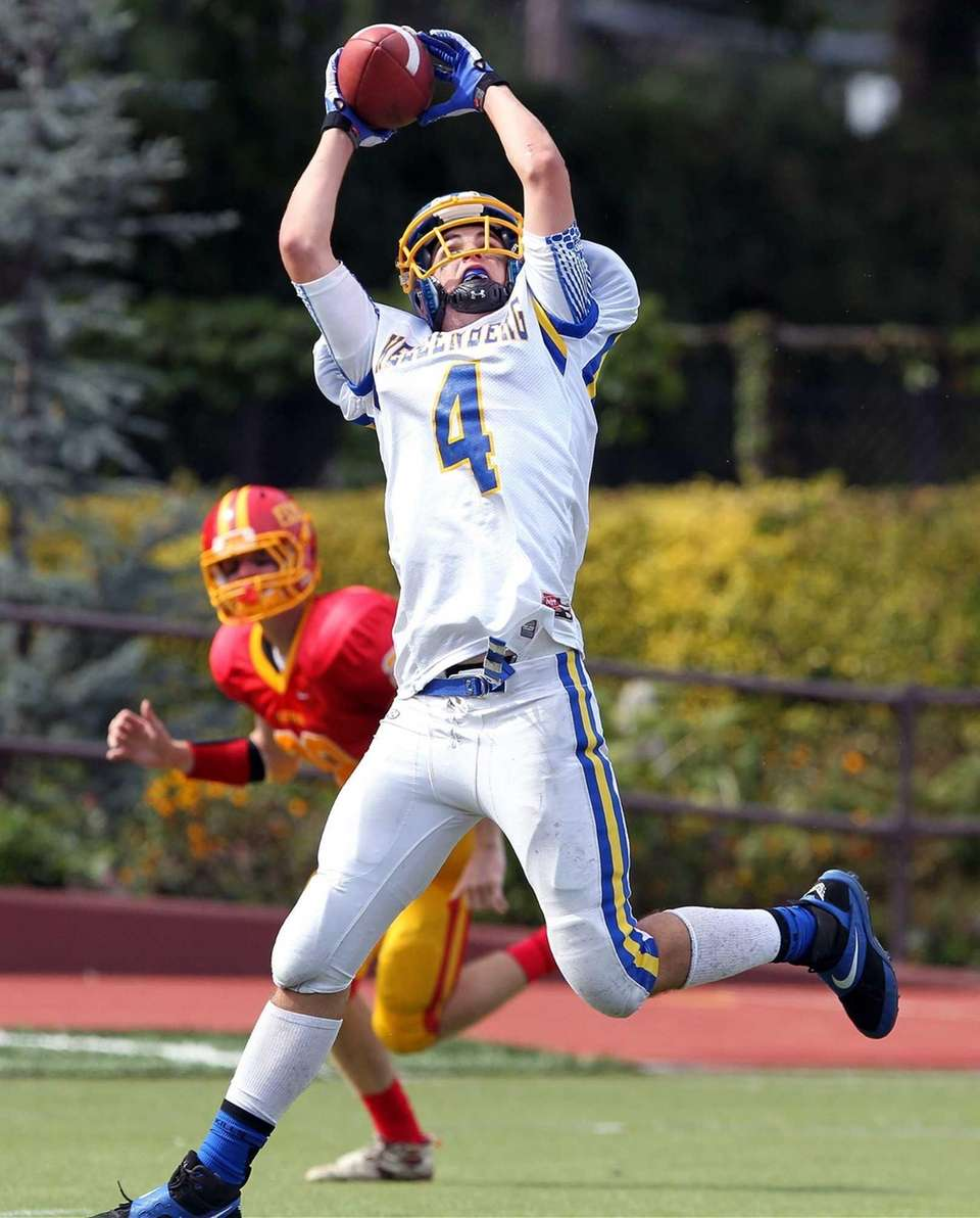 Kellenberg's Connor Goss catches a touchdown against Chaminade.