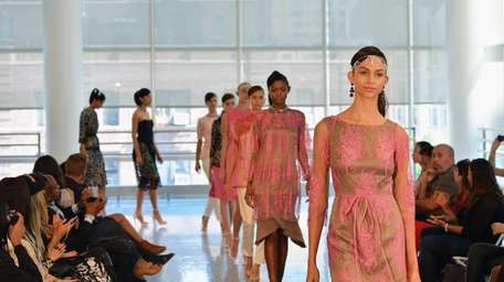 Models walk the runway at the Yuna Yang