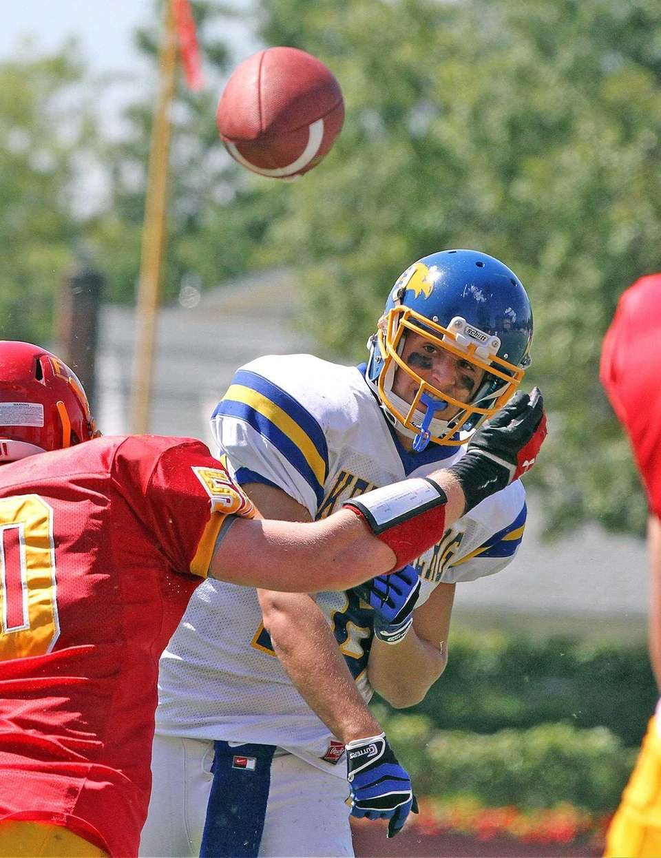 Kellenberg quarterback Kyle Driscoll throws over the middle