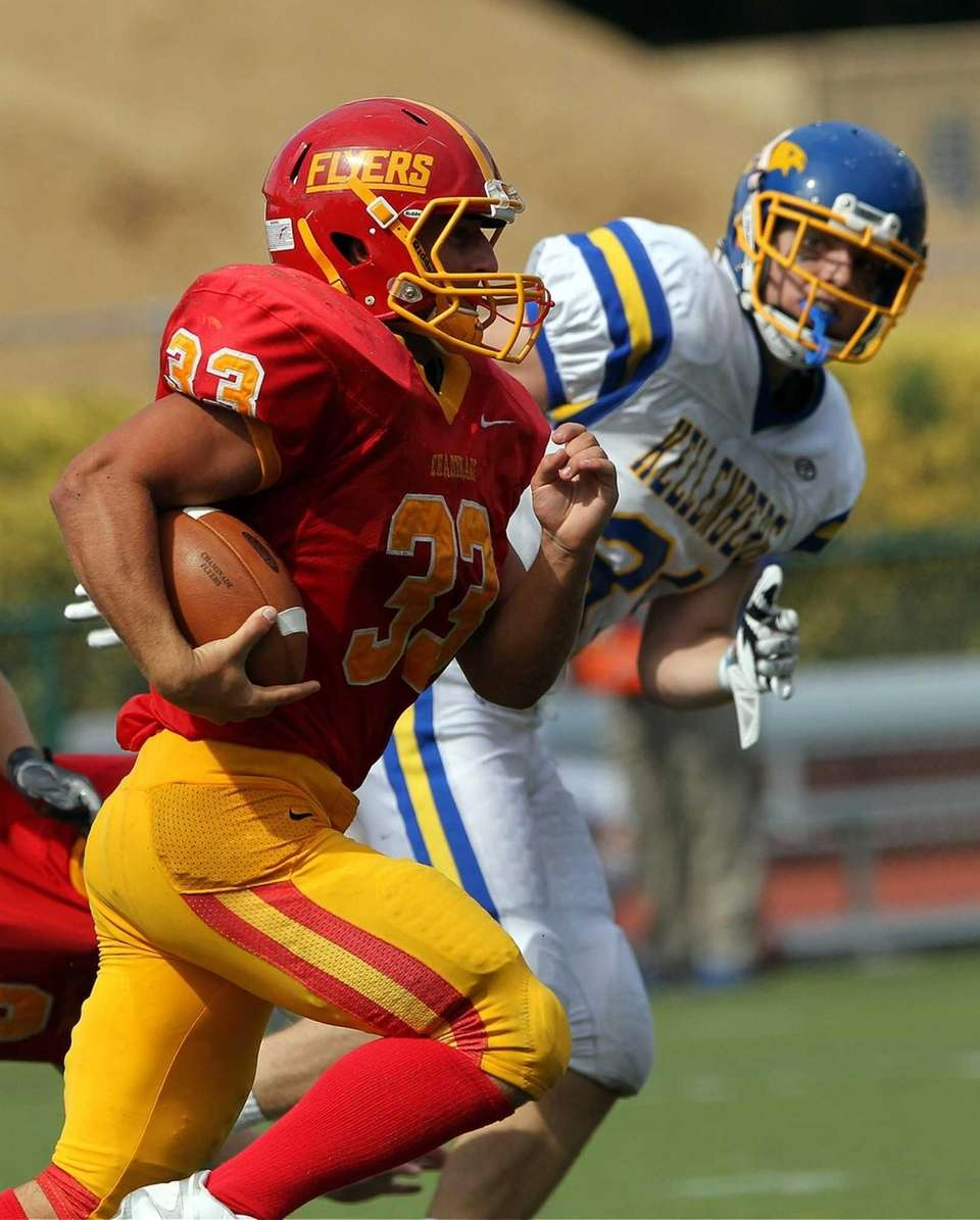 Chaminade's Robert Speranza Jr. carries the ball against