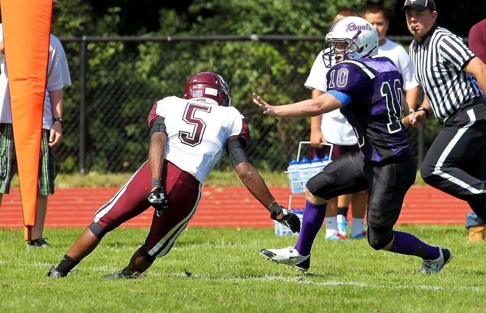 Port Jefferson RB Paul Cavanagh #10 looks to