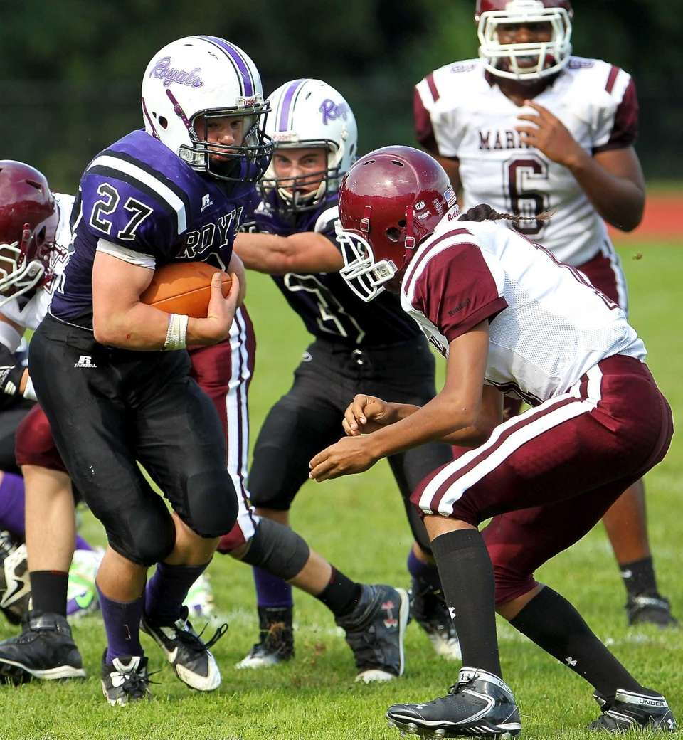 Port Jefferson FB Hunter Reiter #27 carries the