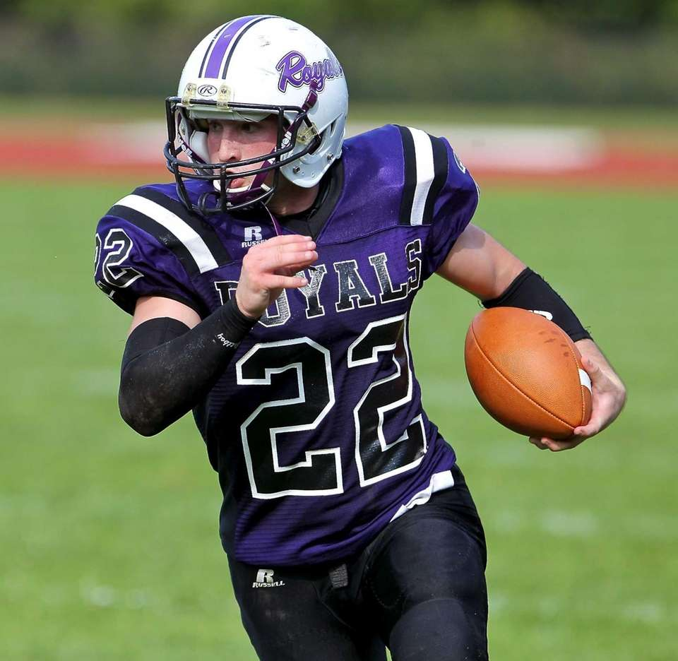 Port Jeff QB Tyler D'Accordo #22 carries the