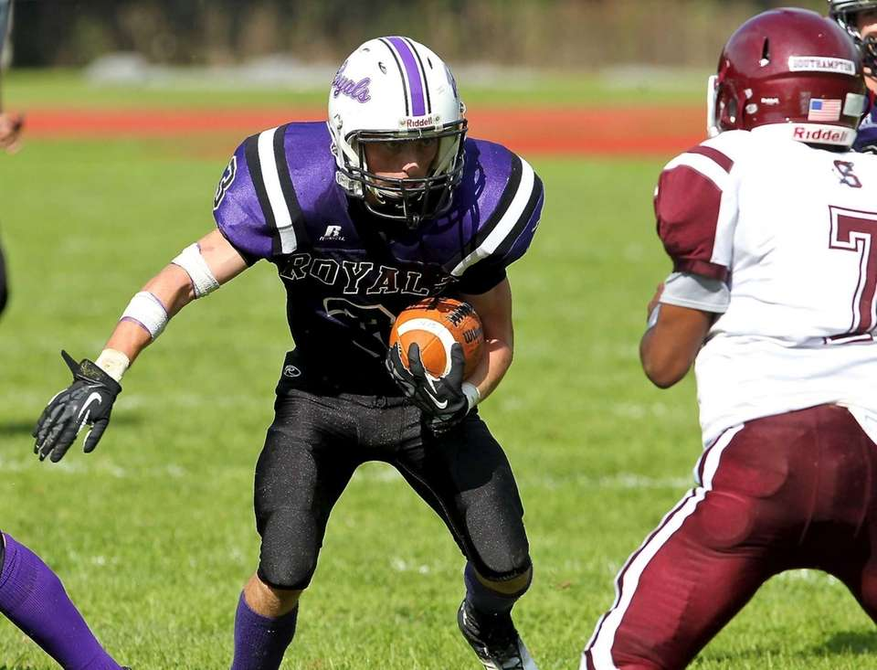 Port Jefferson RB Douglas Crawford #3 carries the